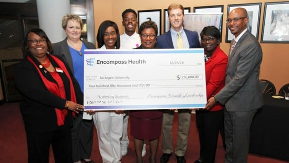 Group shot presentation of check form Encompass Health to Tuskegee University