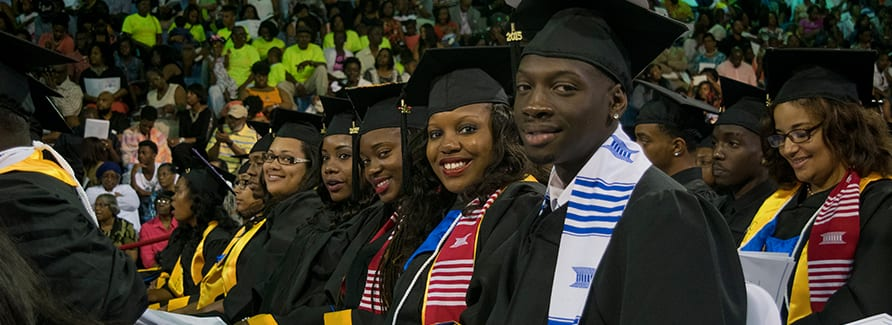 Group shot of Voorhees College students during graduation ceremony wearing caps and gowns