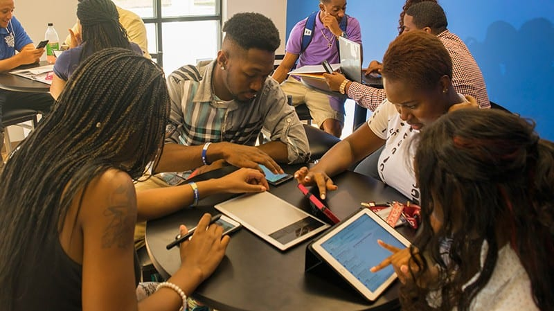 Group shot of Voorhees College students studying using tablets
