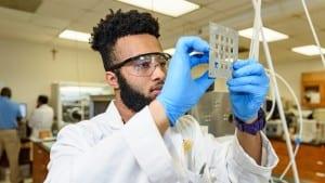 Male Xavier University student working in laboratory