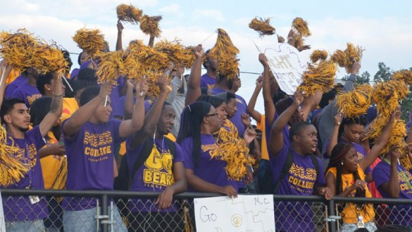 Miles College students cheering during game with pompoms