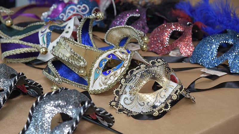 Masks on table at Milwaukee Mayor's Masked Ball