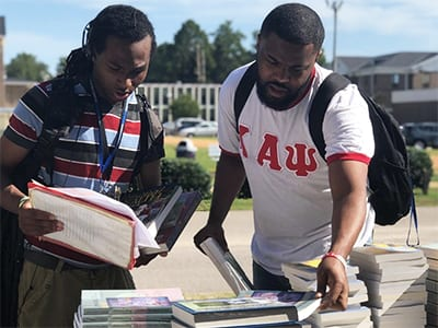 2 morris college students looking at books