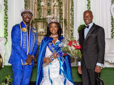 Mr. Morris College 2019/20, Deangelo Adams, and Miss Morris College 2019/20, Aun'ye Wilson, with Pres. Staggers.