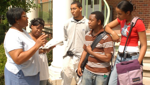 4 Paine College students talking to a professor outside on campus