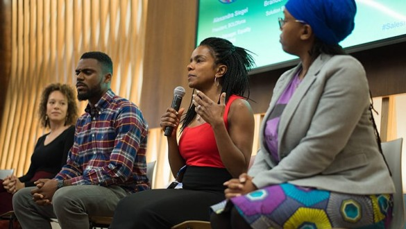 4 panelists speaking at a conference