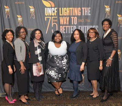 Princeton Committee members with previous scholarship recipient Aliya Grooms