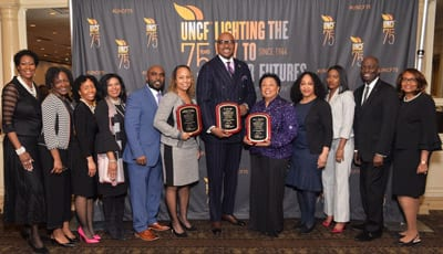 Princeton Committee members and UNCF Newark staff alongside event honorees