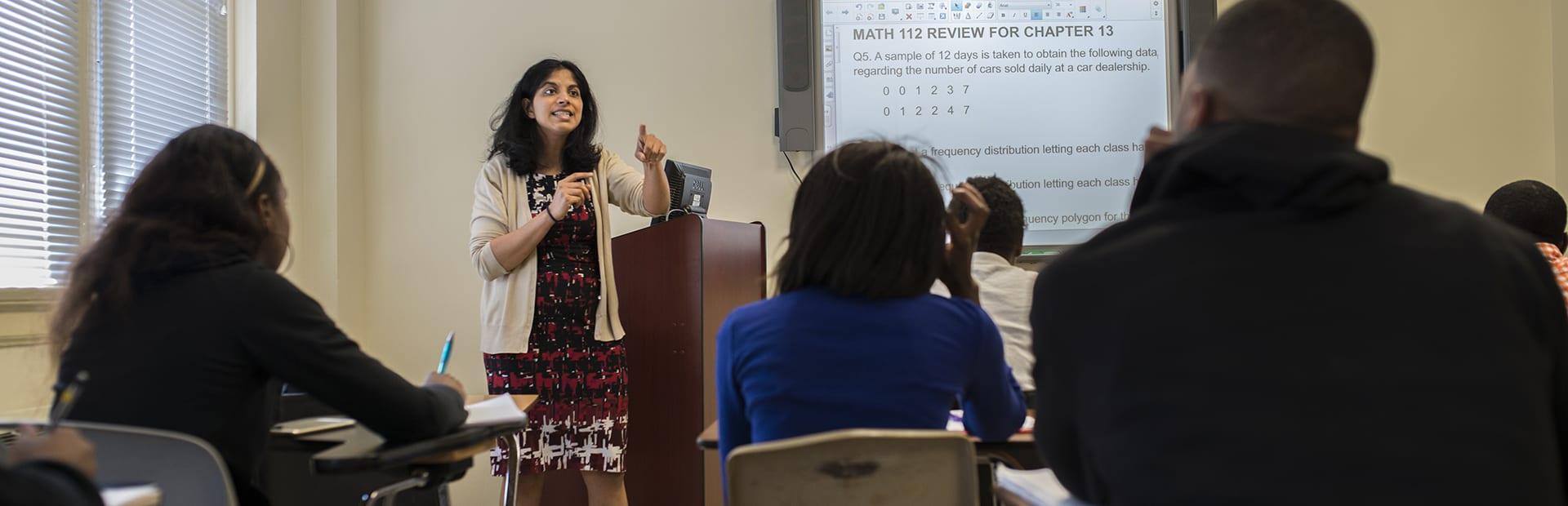 Teacher speaking in front of students in class