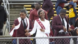 MIss Shaw University and others by bleachers at Homecoming game
