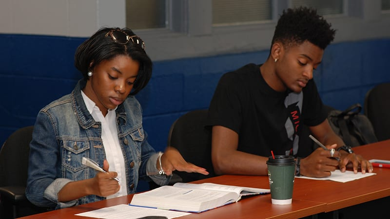 Two Stillman student volunteers at an event