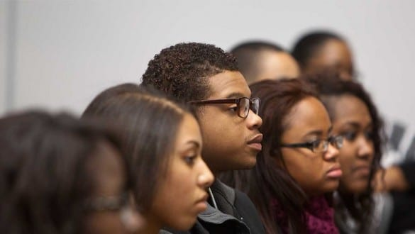 Headshot of students sitting in classroom listening during a lecture