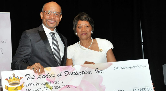 Top Ladies of Distinction presents check to UNCF's Maurice Jenkins