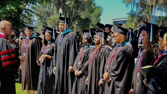 Students being addressed on graduation day