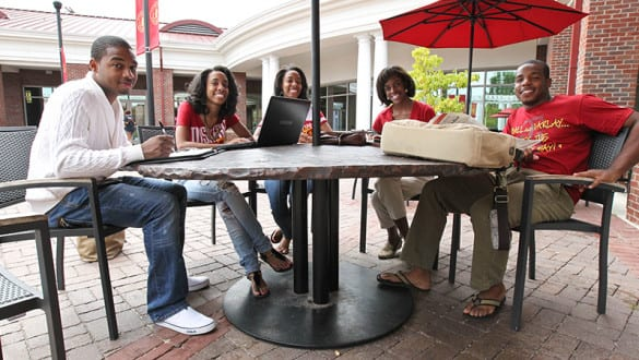 Tuskegee students sitting together at an outdoor table