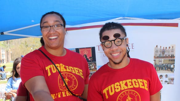 Tuskegee students under tent at open house event
