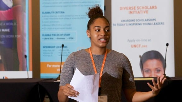 Female walton fellow speaking during conference