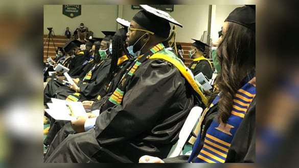 A group of graduates attending the 2021 spring commencement